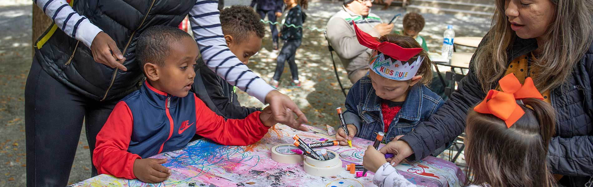 Children painting and learning to make art