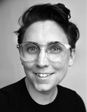 Liss LaFleur, black-and-white portrait, head and shoulders, short hair, wearing glasses