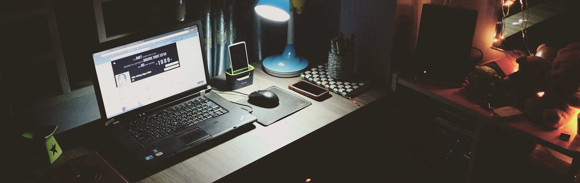 Laptop on a desk, dark room