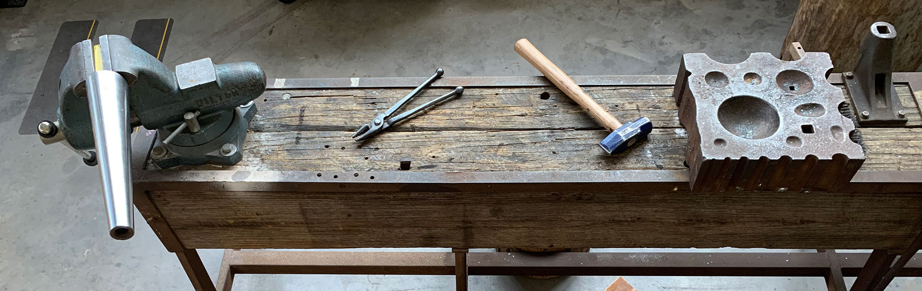 Metalsmithing workbench and tools