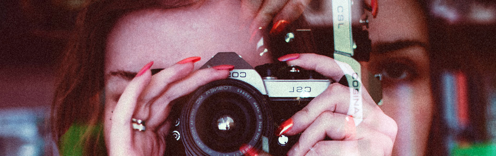 example of a double exposure of a woman taking a photo